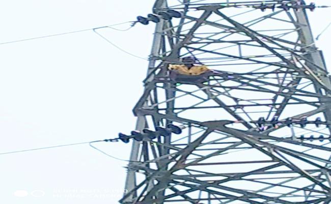 Aperson Climed Hightension Tower For Bike - Sakshi