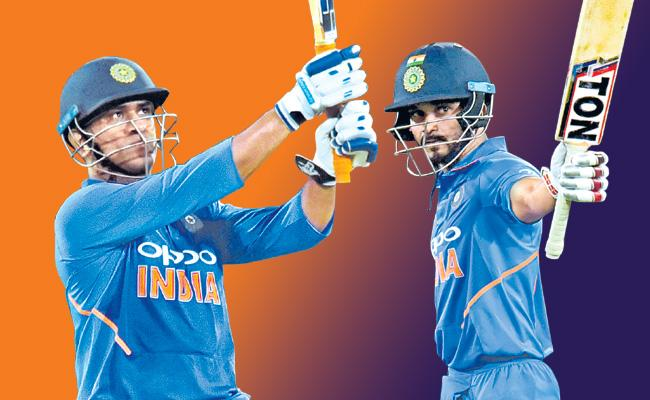 Team india beats ausis in hyderabad odi match - Sakshi