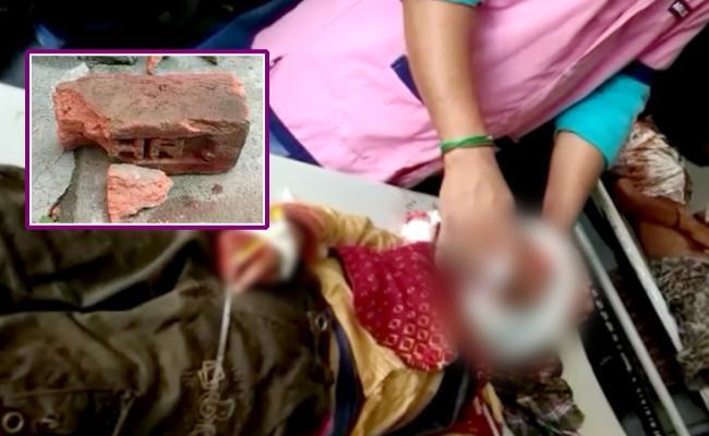 In Peddapalli District Mother Beating Children With Brick - Sakshi