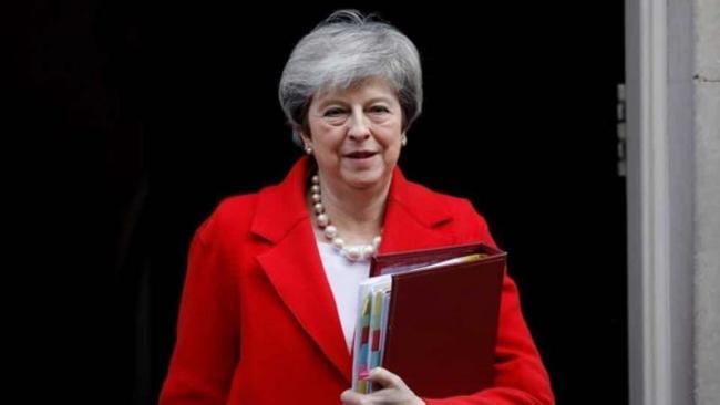 UK PM Theresa May tells Imran Khan Act Against Terror Groups - Sakshi