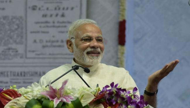 PM Narendra Modi Donates Huge Amount To Kumbh Mela Sanitation Workers - Sakshi