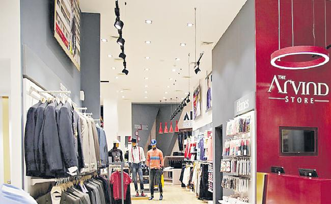Arvind Fashions share lists on BSE, NSE; stuck in upper circuit of 5% - Sakshi