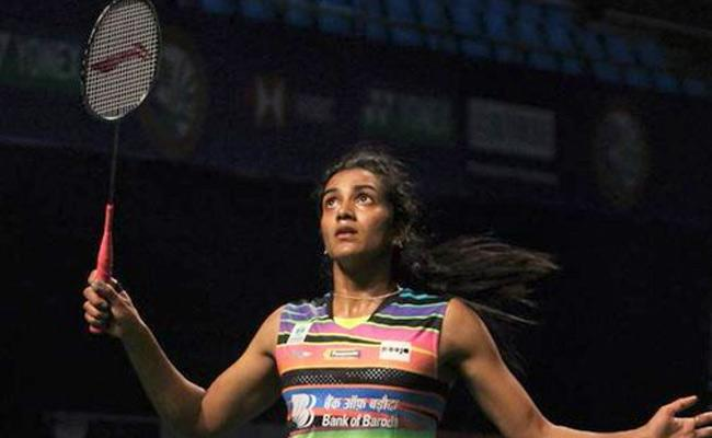PV Sindhu storms into semi final of Singapore Open - Sakshi