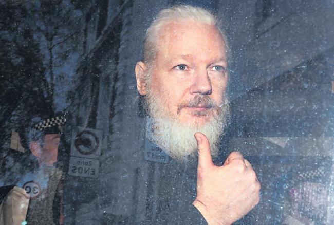 Wikileaks co-founder Julian Assange arrested in London - Sakshi