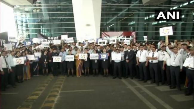 Jet Airways Staff demonstration at Delhi Airport against Jet Airways Management  - Sakshi