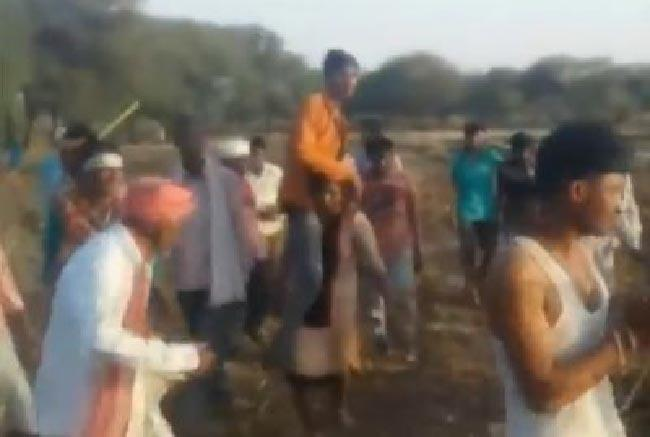 Forced To Walk With Husband On Shoulders - Sakshi