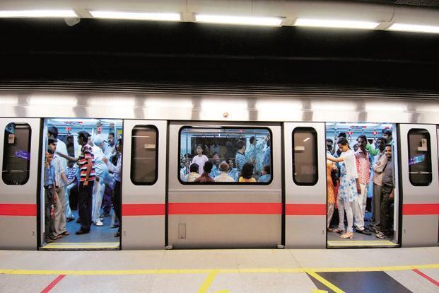 Woman dragged on platform after saree gets stuck in metro door - Sakshi