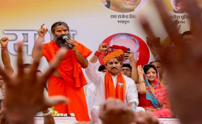 Baba Ramdev Claims Crores of Funding Being Pumped by Christian And Islamic Nations to Prevent Modi Win - Sakshi