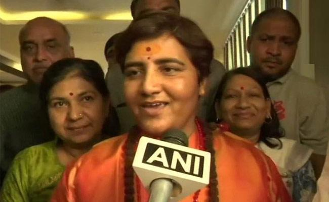 Sadhvi Pragya singh joins BJP, may contest against Digvijaya Singh  - Sakshi