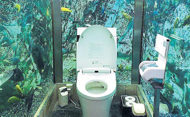 Aquarium Toilet in Japan Cafe - Sakshi