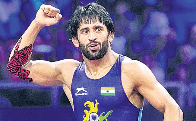 Wrestler Bajrang Punia becomes world number 1  - Sakshi