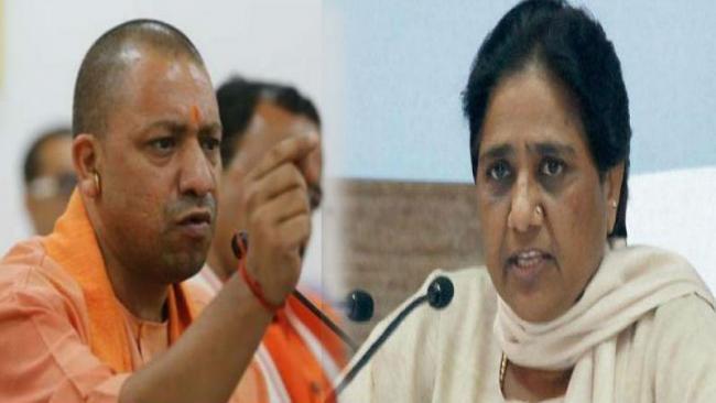 Mayawati  claims  Adityanaths Temple Visits Violated EC Order - Sakshi