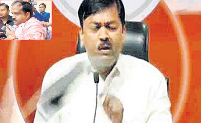 Shoe hurled at BJP MP GVL Narsimha Rao during press conference - Sakshi