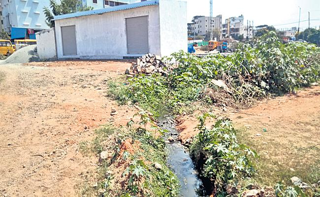 constructions in Pond Lake in Rajendranagar - Sakshi