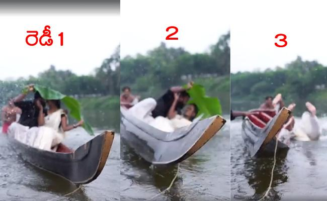 couple falls into river while trying to kiss on a canoe during pre-wedding shoot - Sakshi