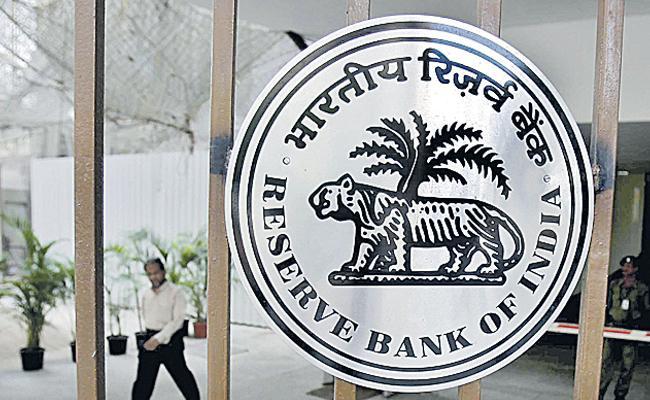 RBI makes NPA divergence rule easier for banks - Sakshi