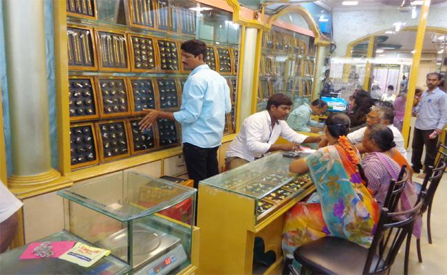 Gold Prices Down in West Godavari - Sakshi