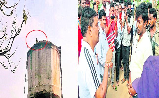 Young Man Climbs Water Tank For Justice - Sakshi
