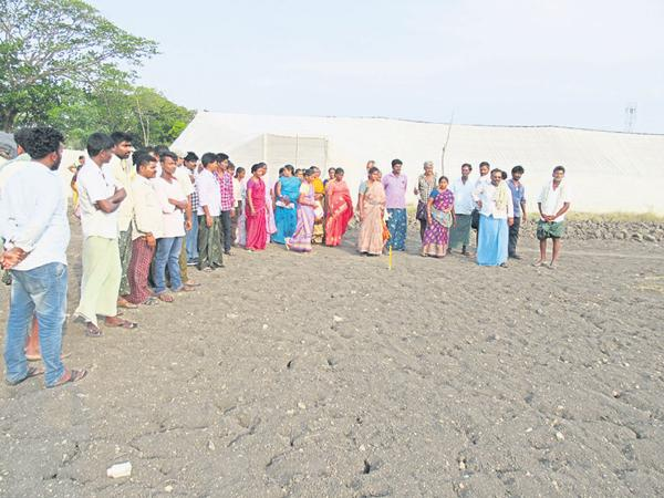 Guntur district officials have prepared for the construction of Bypass road through green fields - Sakshi