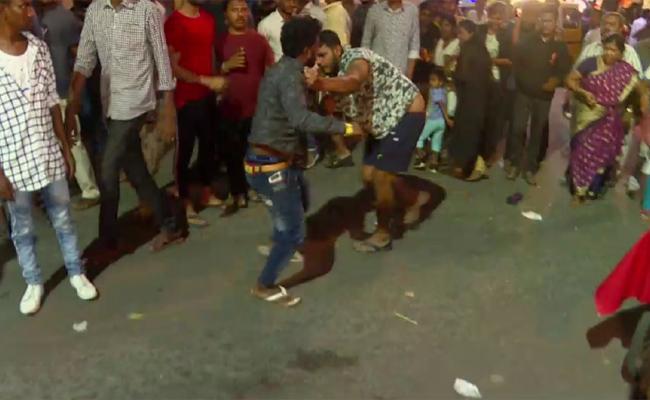 two guys fighting on street for a girl friend in karnataka - Sakshi