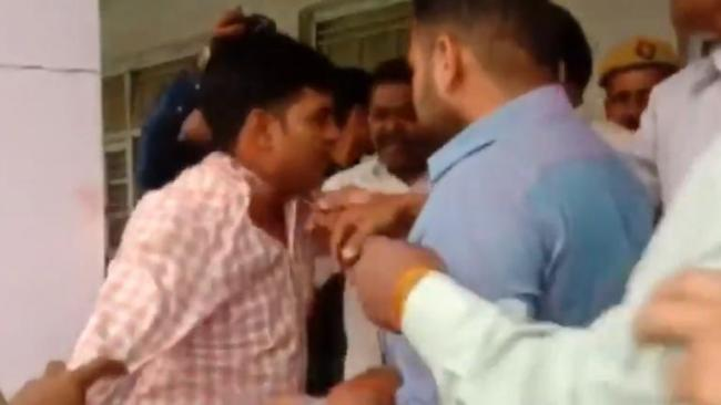 BJP Workers Beat Up Poll Officer In Moradabad - Sakshi