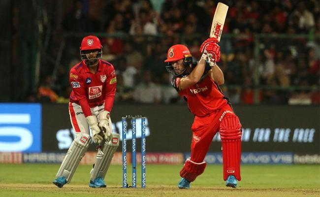 AB de Villiers  blitzkrieg launches RCB to 202 Against Kings Punjab - Sakshi