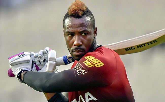 Chris Gayles Advice Of Using Bigger Bats Has Helped Me, Russell - Sakshi