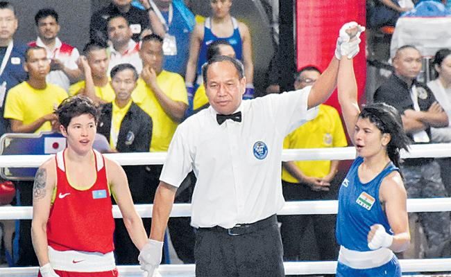 Nikhat Zareen upsets two-time world champion to enter semi-finals  - Sakshi
