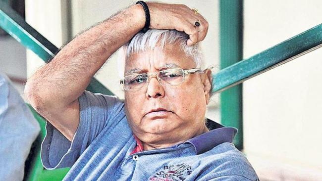 Lalu Prasad Yadav will contest against real Lalu's samdhi - Sakshi