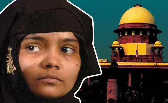 Supreme Court Say pay Compensation To Bilkis Bano - Sakshi