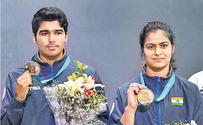 Manu Bhaker And Saurabh Chaudhary Clinch Gold Medal  - Sakshi