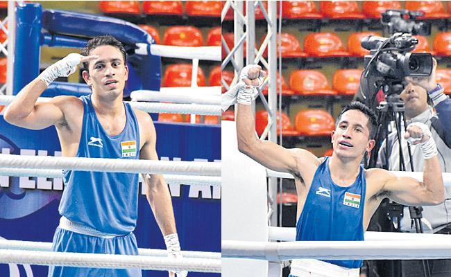 Amit Panghal And Kavinder Singh Bisht among six Indians to reach finals - Sakshi