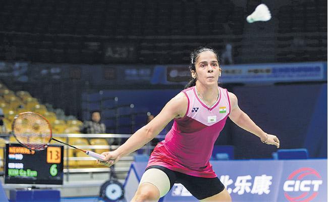 PV Sindhu And  Sameer Verma Reach Quarter Finals - Sakshi