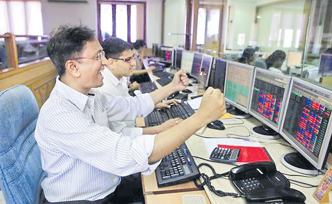 Sensex surges 336 pts, Nifty tops 11750 as crude oil eases - Sakshi