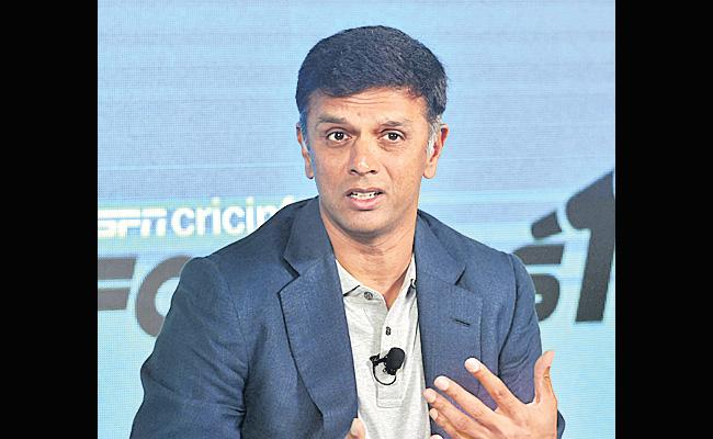 Rahul Dravid is the NCA head coach - Sakshi