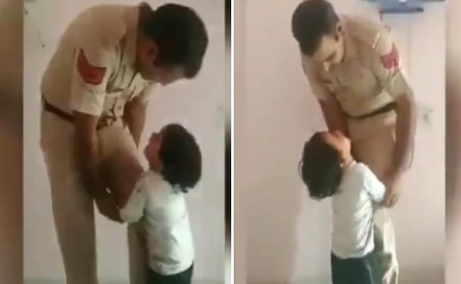 Son Stopping Police Father To Go Office Viral Video - Sakshi