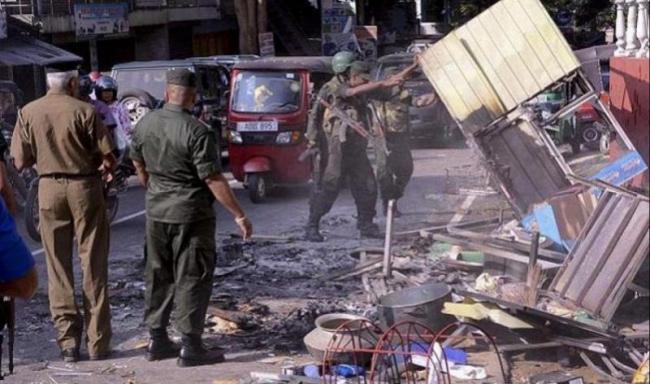 15 dead in gun battle with bombing suspects - Sakshi