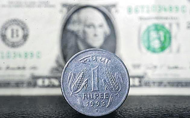 Rupee slumps 76 paise to 69.17 post RBI policy - Sakshi