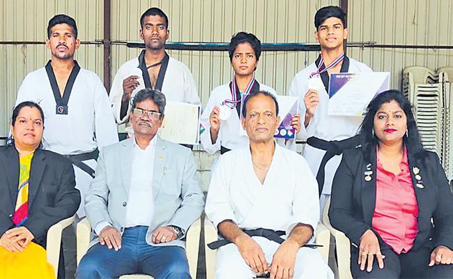 Karan Gets Gold Medla in Taekwondo Championship - Sakshi