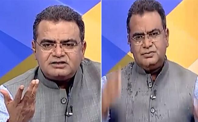 Congress Neta Throws Water at BJP Leader on Live TV Debate - Sakshi