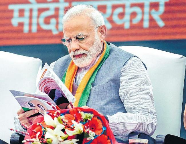 pm narendra modi release bjp manifesto - Sakshi