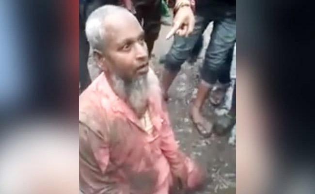 Muslim Man Abused Allegedly Selling Beef In Assam - Sakshi