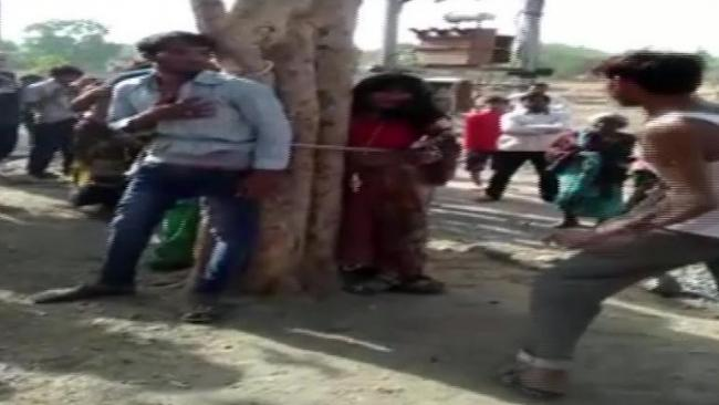 Madhya Pradesh Man Elopes With Married Woman Is Tied To Tree - Sakshi