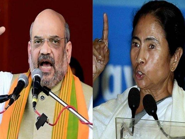 War Of Words Between TMC and BJP Over Clashes In Amit Shah Rally - Sakshi