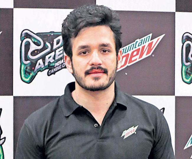 akhil next movie bommarillu bhaskar and gopi sundar - Sakshi