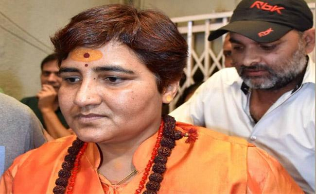 MP Govt to reopen 12 year old murder case against Pragya Thakur - Sakshi