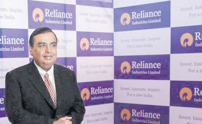 Reliance Industries overtakes Indian Oil to become largest company - Sakshi