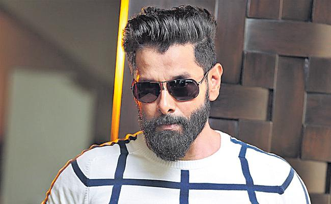 Vikram and director Ajay Gnanamuthu team up for action thriller next - Sakshi