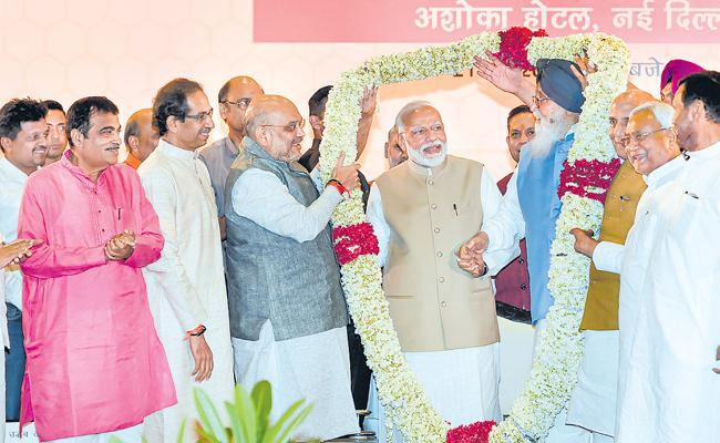 BJP And NDA Are In Full Swing By Exit Polls Survey - Sakshi