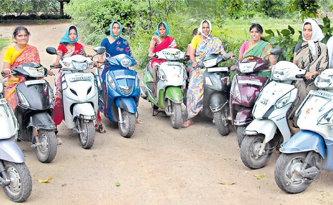 Jagityala District Womens younger farmers are farming on scooters - Sakshi